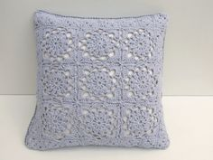 This solid color, lacy crochet cushion is so pretty.  I think a linen insert would be pretty, with a soft color yarn---green, aqua, cream, yellow.