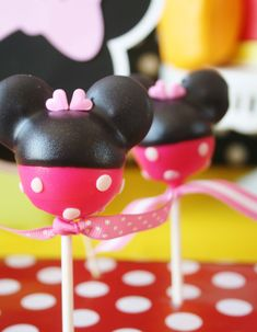 Mini Mouse cakepops. use mini vanilla wafers for the ears. Dip in pink first, then dark choc. fondant dots.