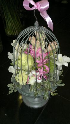 Floral arrangement in bird cage,with Green Beauty roses,nerine,pittosporum,tuberose,dendrobium orchid and green holland dianthus designed by Adrian Ionita