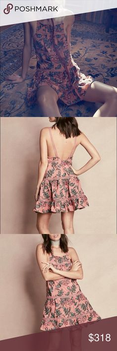 Rosali Tank Dress For Love & Lemons Rosali Tank Dress. This gorgeous mini dress features a fully embroidered all over rose and vine print, soft and flowy dusty rose construction, tiered A-line cut that pleats softly towards the hem, open crocheted detailing across each tier, square neckline, and a sweet open back.   MAUVE FLORAL Materials: 55% Viscose, 45% Rayon Dry Clean Only For Love and Lemons Dresses Mini