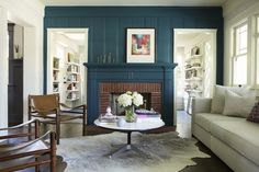 Simo Design - living rooms - painted wood paneling, red brick fireplace surround, painted fireplace surround, dark teal wall color, dark tea...