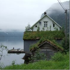 marvelous misty white house on the edge of the water, Norway