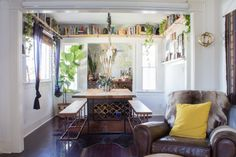 Want to do this - Shelves around dining room, above windows. Place to put tchotchkes out of the way.......Alex and Max's Earthy and Eclectic Venice Bungalow