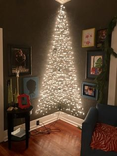 3D corner Christmas light wall tree. - Make one of these on the wall by my desk with orange lights next year & hang tinsel on it.