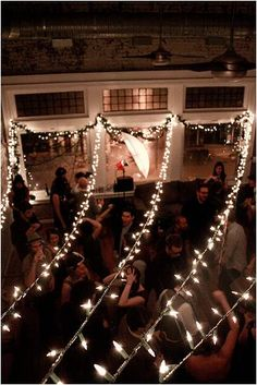 By simply draping some lighting across the top of your venue or outside area you can transform the entire space. This 1920's themed party has a wonderful feel through just adding some small effective touches.