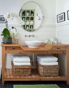 Building a bathroom vanity allows you to customize the unit to your unique storage needs and style preferences. Refinish a flea market find, update an existing stock cabinet, or upgrade a retail table for a personalized DIY bathroom vanity you'll love. #bathroomideas #bathroomdecor #diybathroomvanityideas #bathroomremodel #bhg