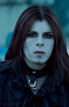 Beautiful Gothic Male in perfect understated manner. Eyeliner, no theatre white or black make up in designs on his face, long slightly disheveled hair, clothing is elegant and not studded everywhere. This is Goth. ~ Lady Lilith