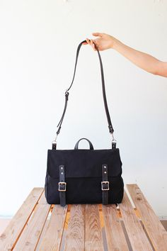 Waxed canvas messenger bag with black leather details, waxed canvas satchel, laptop bag, 4 colors by Phestyn on Etsy https://www.etsy.com/listing/226527066/waxed-canvas-messenger-bag-with-black