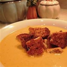 Whole wheat cinnamon croutons top this creamy soup made with chicken broth, pumpkin puree, and warming spices.