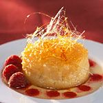 Baked Pear Caramel with Berry Sauce.