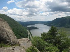#1 Breakneck Ridge Trail: In Hudson Highlands State Park, this trail makes a rugged ascent from river-level to roll along a knobby ridge, gathering vistas and reaching a lookout. Special Attractions: Hudson river, Shawangunk, and Catskill Mountains vistas; old fire lookout tower; mixed forest; mountain laurel and spring and summer wildflowers. Expect some hand-over-hand rock scrambles and wear boots that protect ankles. High winds and rain increase risk of the rocky ascent.
