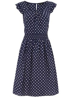Blue spot print sundress. All this outfit needs is a pair of pumps, a cardigan, and some victory rolls :)