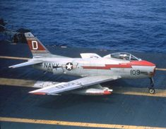 US Navy - North American Aviation Fury - Was a Swept Wing Carrier Capable Fighter Bomber – Powered by: 1 × General Electric Turbojet, Rated at: lbf Thrust – Armament: 4 x Cannon Military Jets, Military Aircraft, Sabre Jet, Us Navy Aircraft, Aircraft Painting, American Fighter, Armada, Aircraft Design, Aircraft Pictures