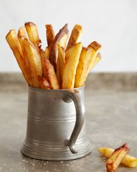 Do you like French Fries?  If your like most people, Fries are a weekness we all seem to Love... Here is the secret to perfect French Fries!   -   Thrice-Cooked Fries Recipe on Food & Wine.      The Breslin • Manhattan  These fries have a cult following at The Breslin. Boiling makes the potatoes tender; double-frying makes them insanely crispy.