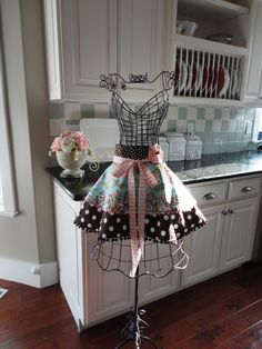 Iron bust in kitchen to display and house cute apron - my only critique is the bow to the side would be better it's at risk is losing the apron look and end up with a backless skirt but I love the fabrics and design :)