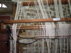 100 metres of warp on my upright loom is quite a sight, at least in my eyes! Yes, I have 100 metres spaced at 8 e.p.i to play on. There is still some work needed before I tie it on, but then, witho…