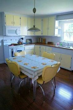 Yellow and white with vintage style table and chairs.