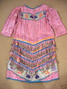 Girls Appliqued Jingle Dress Regalia - Size 14-1 6 Jingle dresses are usually priced based on $1 per cone, plus $50-$85 per applique. This means that this dress (which has 307 jingles and four sets of