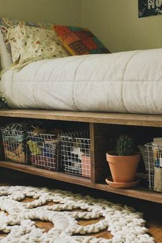 Platform Bed with Storage and Baskets | Creative Pieces Of Wood For A New Bedroom With A Storage by DIY Projects at   https://diyprojects.com/14-diy-platform-beds/