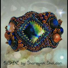 Check out this item in my Etsy shop https://www.etsy.com/listing/265733642/nebula-a-star-is-born-bead-embroidered