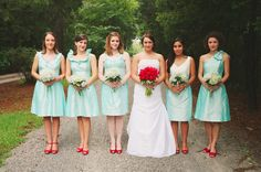 Same colors as my upcoming wedding. Love the mismatched bridesmaids. Planning on doing something similar, although I'm not sure whether to have red dresses with aqua accents or this. #bridesmaids