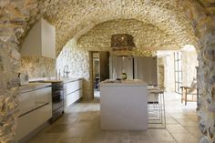 modern kitchen and rustic stone walls