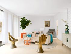 ICONIC HAND CHAIRS: mid-century #modern inspired living room #design + vintage gold leaf #chairs