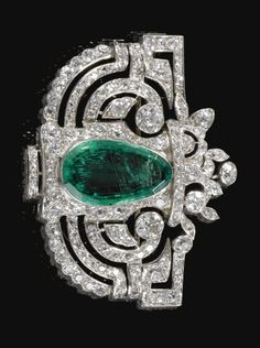 An Art Deco emerald and diamond brooch, 1920. Of stylised giardinetto openwork design, centring on a pear-shaped emerald highlighted with circular- and single-cut diamonds.
