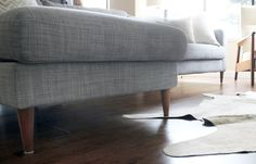 A Simple Hack That Makes an Ikea Sofa Look Like a Million Bucks - Uncle Bob's Workshop sells superaffordable legs specifically for Ikea couches. They chose solid walnut ones for a more expensive, midcentury look. Furniture, Furniture Hacks, Ikea, Friheten Sofa, Ikea Kivik, Ikea Couch, Sofa Legs, Ikea Sofa, Ikea Furniture Hacks