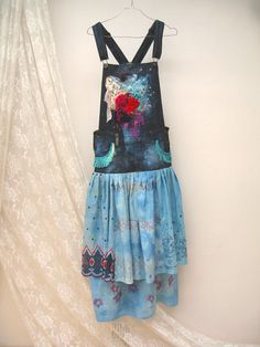 Dungarees Bohemian Skirt, Boho denim skirt, Bohemian festival Dungarees skirt, Hippie Skirt, upcycled clothing, altered couture hand dyed skirt  Lovely bohemian dungarees denim skirt , made of cotton, reworked, Hand-decorated and dyed. with hand embroidery and bead embroidery ,flowers and appliques. Absolutely awesome!!!  unique and beautiful  Size: M waist approx 82cm/ 32.3 inch(Waist adjustable) hips approx 96-98cm/37.8-38.6 inch Length from the waist line approx 90cm/35.4 in...