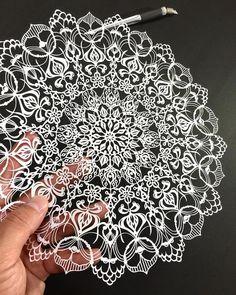 Hand cut paper mandalas by Mr Riu
