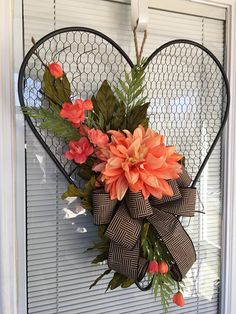 Spring Summer door hanger, Peony wreath, Farmhouse decor Door hanger gives you that farmhouse feel but yet dainty. Colors are coral/pink florals embellished with a natural colored bow nestled on a large chicken wired heart. Dimensions 22L x 20W x 4-1/2D Can be used between most