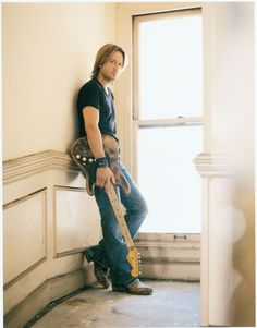 Keith Urban. A man with a guitar always curls my toes