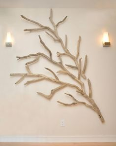 "Driftwood installation by Susie Frazier at Travis Hafner's home in Cleveland, OH. Over 30 different logs from the shores of Lake Erie were joined and mounted to the wall using 2"" stainless steel standoffs. Great for giving a ""floating"" effect!"