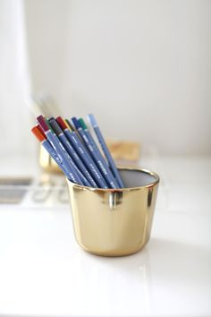 Pencil holder with personality: http://www.stylemepretty.com/living/2015/08/18/22-tricks-to-make-your-office-somewhere-you-enjoy-spending-time-in/