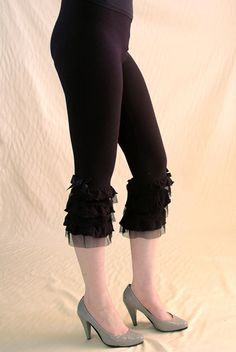 Cabaret Leggings Six rows of ruffles at the hem A silk bow Ideal for layering under skirts and dresses Made of cotton spandex jersey and nylon knit netting for