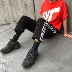 711305073444c yeezy 500 utility black Adidas socks and track pants Orange tee