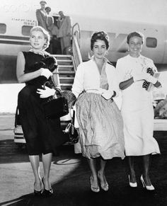 TWA Connie at IDL, September 1954, New York, USA --- This beautiful threesome arrived on the same TWA plane from the West Coast, nonstop from Los Angeles, and it was almost too much to take all at once. From left are movie star Grace Kelly, starting a long vacation; Elizabeth Taylor en route to join her husband, Briton Michael Wilding, and Laraine Day, here to root for the New York Giants, master minded by her husband Leo Durocher. --- Image by © Bettmann/CORBIS