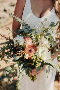 Rustic bouquet with overflowing foliage | image by Taylor Roades