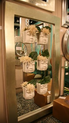 Always a show favorite! Howard Elliott mirror with new Buddha Wall Art Vases affixed to it  High Point 10/2013