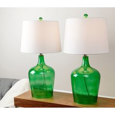 These table lamps have bases that protrude from antique jade green glass jugs