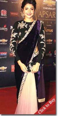 Anushka Sharma looking good in Sabyasachi designer sarees at film event.