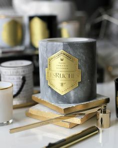LesRuches luxury organic beeswax designer candles in our best selling scents: Cassis, Bois de Santal, Cassonade and Chèvrefeuille Santal.