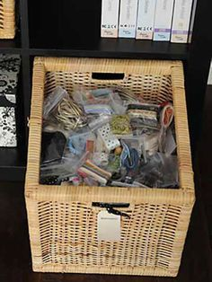 Irma stores embellishments and other small items in plastic bags and places them in large wicker baskets. The baskets fit perfectly in deep bookcases or can easily slide under a desk for convenient storage./