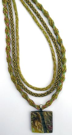 What a Knit Kumihimo Artist of the Month Cheryl Parsons - Hixon, Texas - 12 Strand Ridge Spiral in Kumihimo Rayon Gimp - 8 strand Round Braid using Petite Satin Cord - 8 strand Square Braid using Kumihimo Rayon Gimp