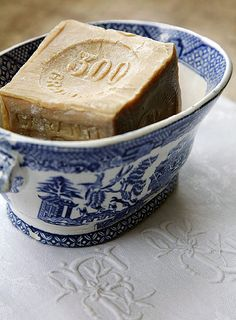 Monogrammed linens, blue willow china soap dish, and french milled soap...lovely details. ~