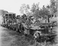 Australian Army jeep train pulling members of the 24th Infantry Brigade. Beaufort, Borneo. 22 July 1945. Australian War Memorial Photo