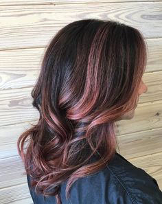 Aveda Artist Whitney added hand,painted layers of rose gold balayage to her  dark brunette