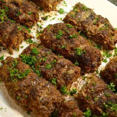 Persian Kebab Koobideh are juicy strips of charbroiled, seasoned ground beef. Serve with delicious golden rice called Chelo and you have Chelo Kebab. Kebab Recipes, Indian Food Recipes, Beef Recipes, Cooking Recipes, Ethnic Recipes, Afghan Food Recipes, Arabic Recipes, Chicken Recipes, Iranian Cuisine