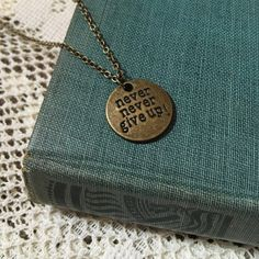 Never Never Give Up! Necklace Please feel free to make an offer!! :) I'd be happy to answer any questions you may have or bundle up a few of your favorites at a discounted price. :) Jewelry Necklaces
